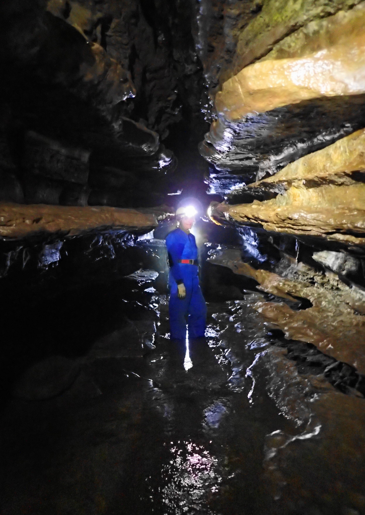 Patricia in the cave. Ogof Clogwy is known for the very pronounced shelving